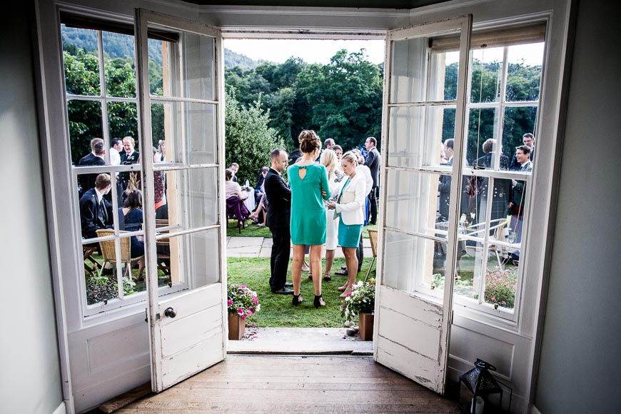 Wedding Guests Talking Outside And Enjoying Drinks Canapes At Eastwood House