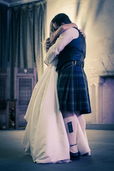 Bride and groom hugging and holding while dancing