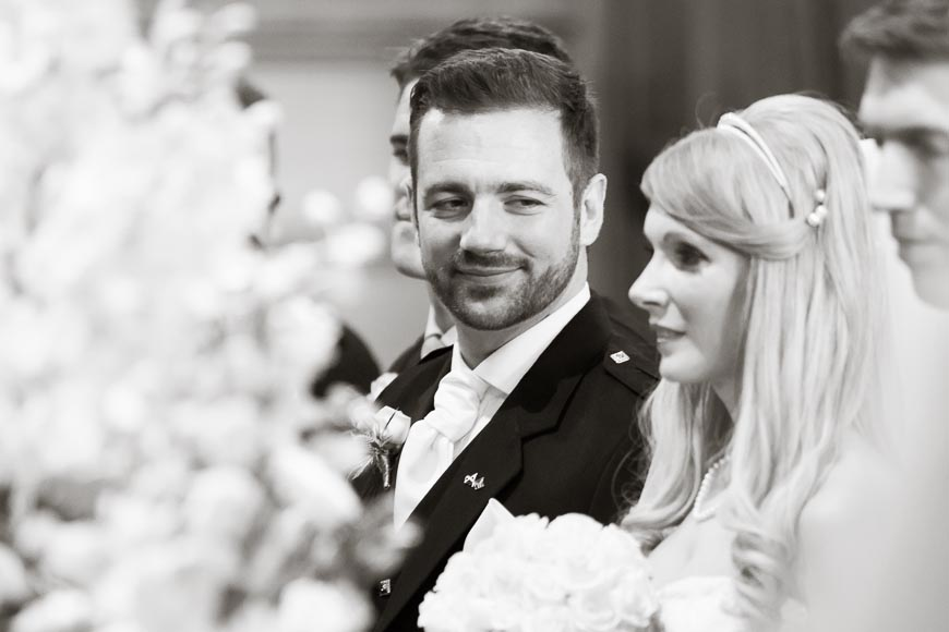 Groom affectionately gazes at his lovely bride
