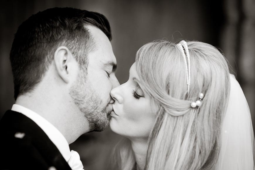 Bride and groom kiss for the first time as a married couple