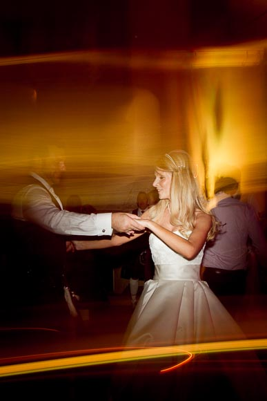 bride and groom dancing into the night