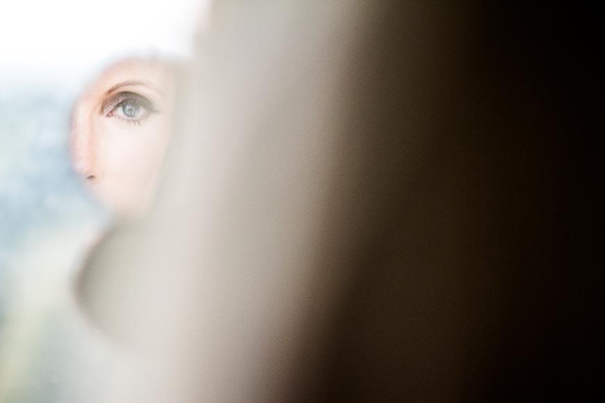 bride looking in small mirror