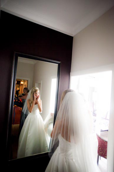 bride surprised at a full lenght mirror