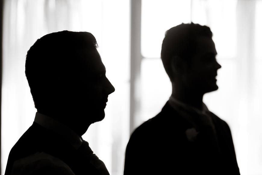 silhouettes of the groom and his groomsmen