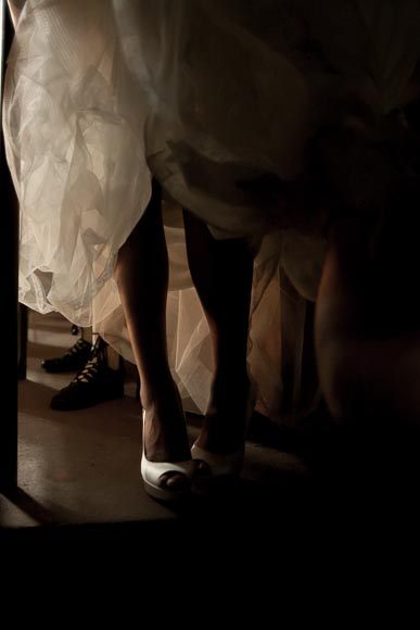 The legs and shoes of the bride