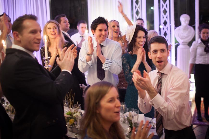 bride and groom receive a thunderous applause from their wedding guests