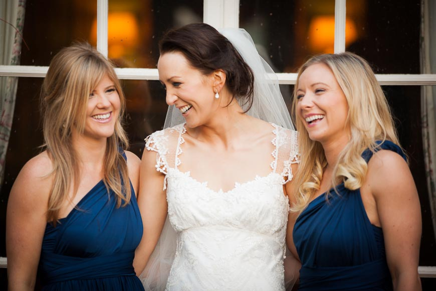 bridesmaids and brides laughing with each other