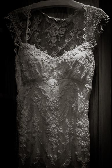dramatic detail of elegant and ornate dress visible in beautiful light