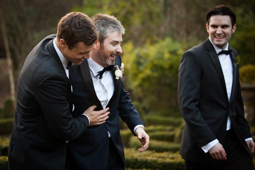 groom laughing with his groomsmen