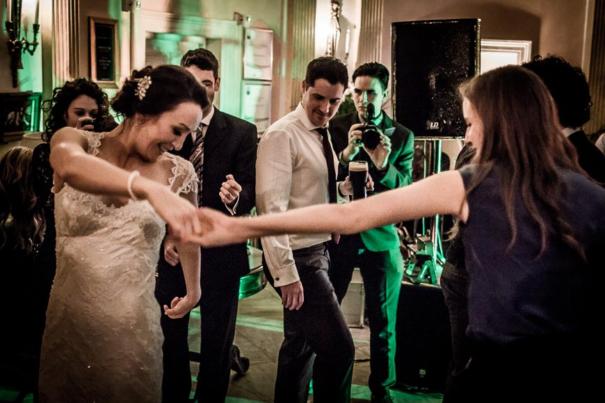 the bride shows her elegance while dancing with one of her wedding guests