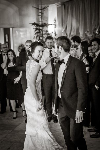 the lovely bride smiling at her groom as they enjoy their first dance together