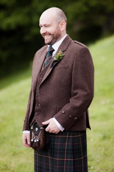 scottish bride groom outside