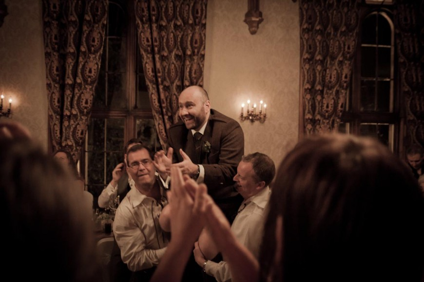 groom lifted at wedding reception