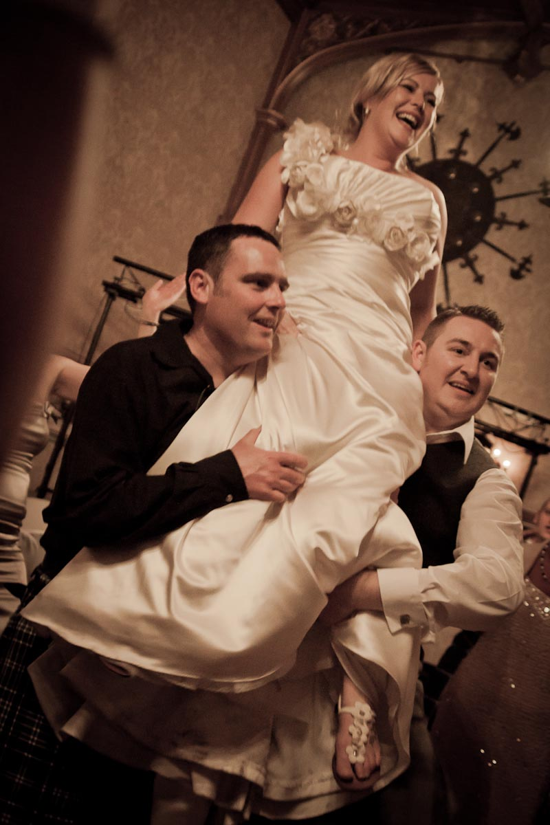 bride lifted at wedding reception