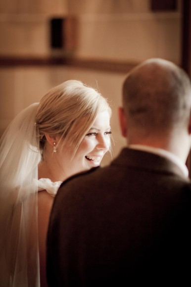 bride and groom laugh at wedding ceremony
