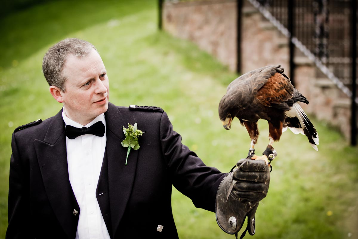 wedding guest with bird of prey