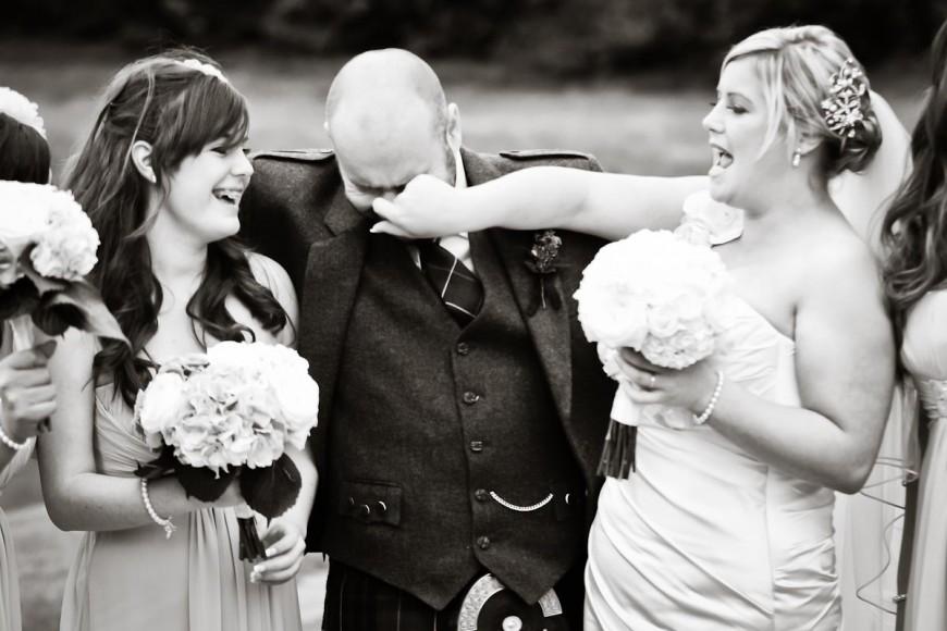 bride grabs groom's nose during wedding photos