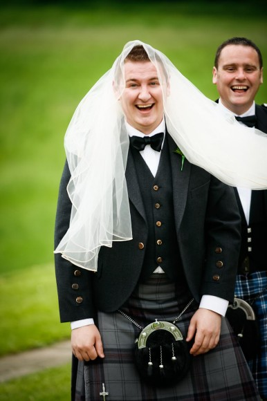 man in bridal veil