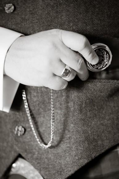 groom gets ready for wedding pocket watch