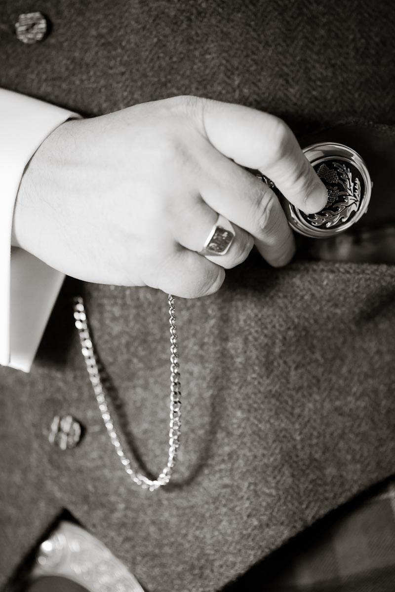 groom gets ready for wedding pocket watch
