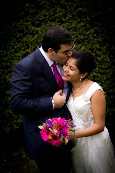 groom kisses wife