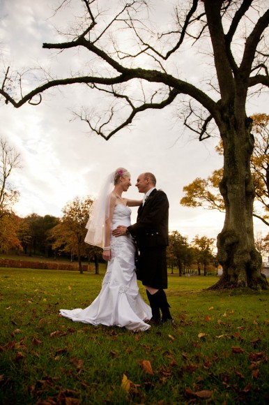bride and groom with autumn trees