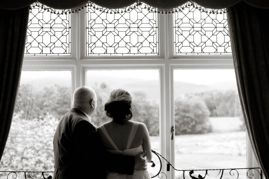 bride and father at window