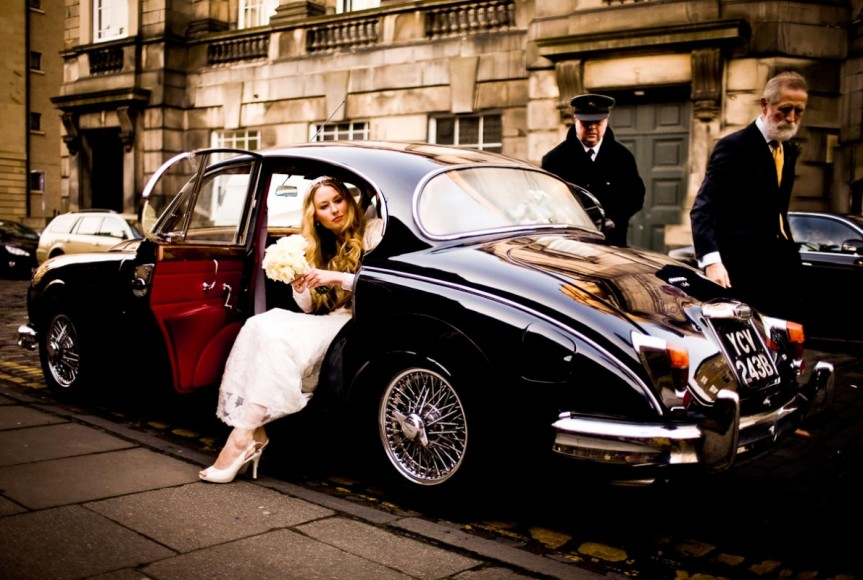 Bride steps out of classic car