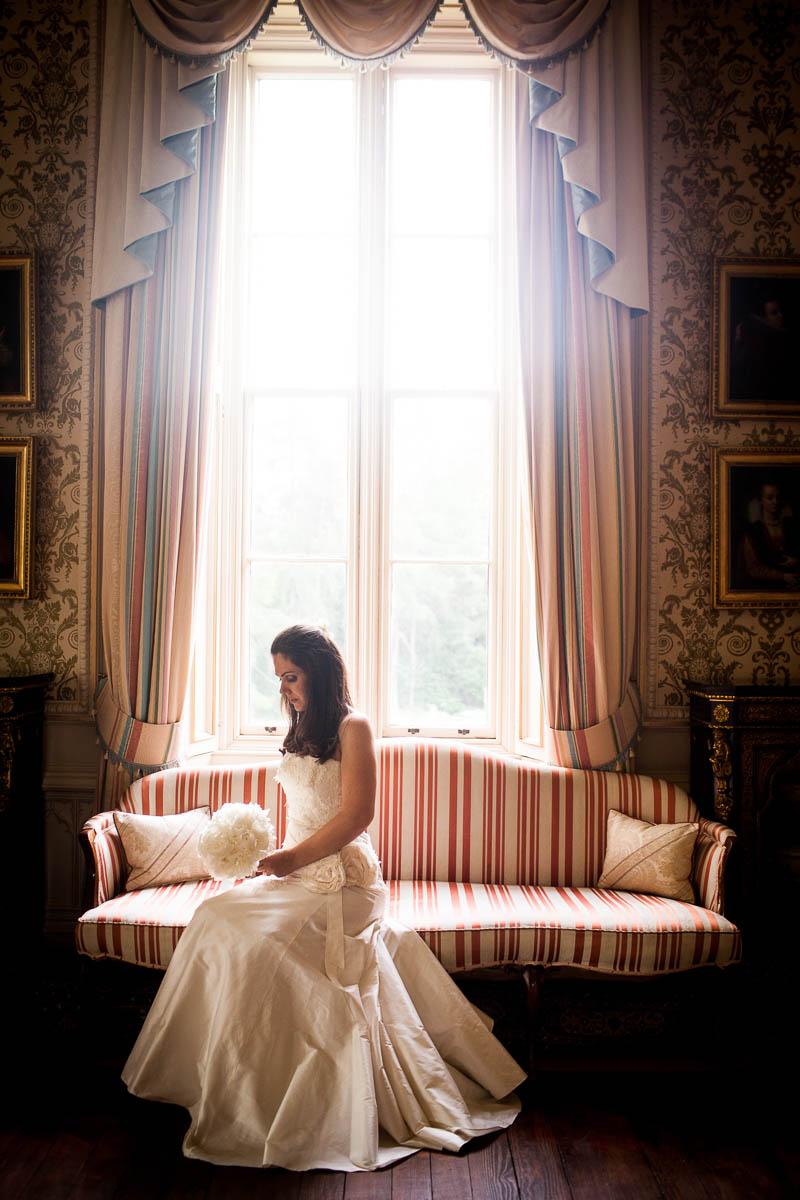 bride by window at drummuir castle