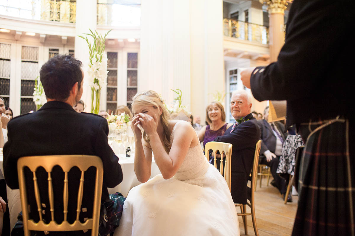 bride laughing during speeches at signet library edinburgh