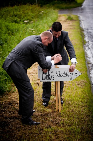 groomsmen put out signs for wedding guests