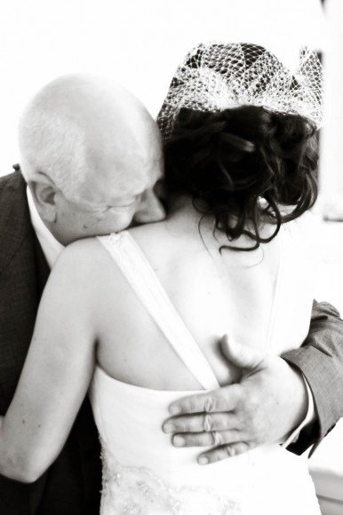 father hugs bride