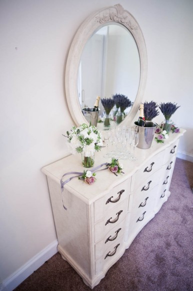wedding flowers on dressing table with mirror