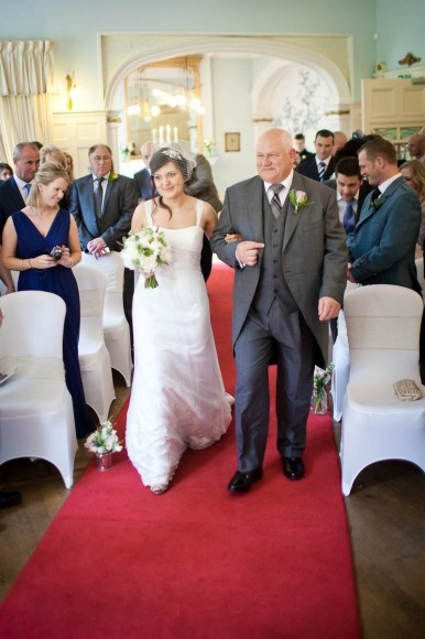 bride coming down aisle with father at solsgirth house wedding