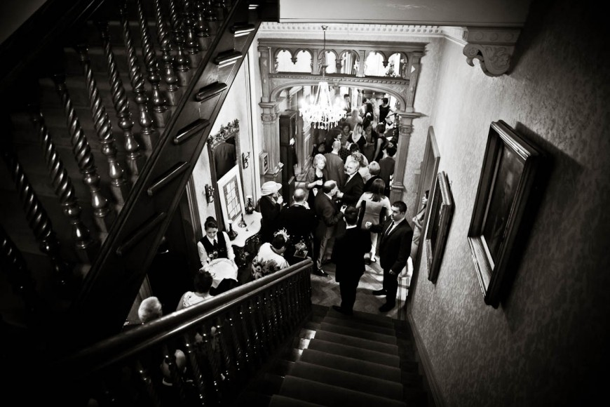 wedding guests from above with stairs at solsgirth house