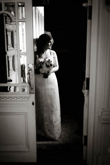 bride through doorway in black and white