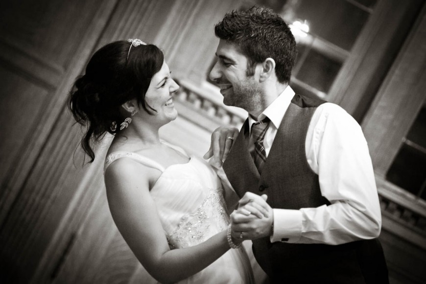 bride and groom dance in black and white