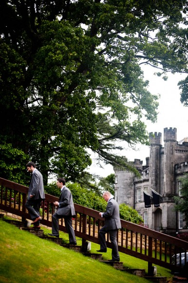 groom and groomsmen climbing steps in grounds of solsgirth house