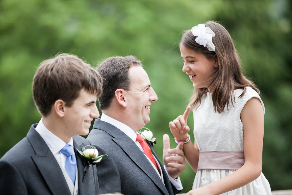 groom talks with guests