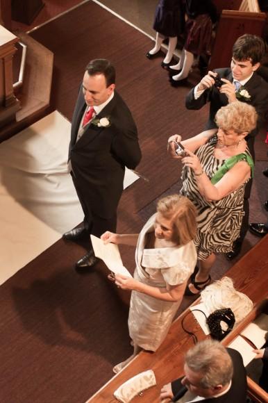 groom waits as bride comes down aisle