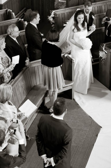 bride coming down aisle at drummuir castle