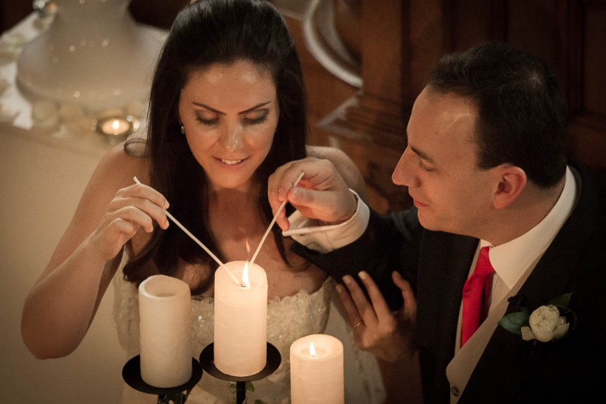 bride and groom light candles