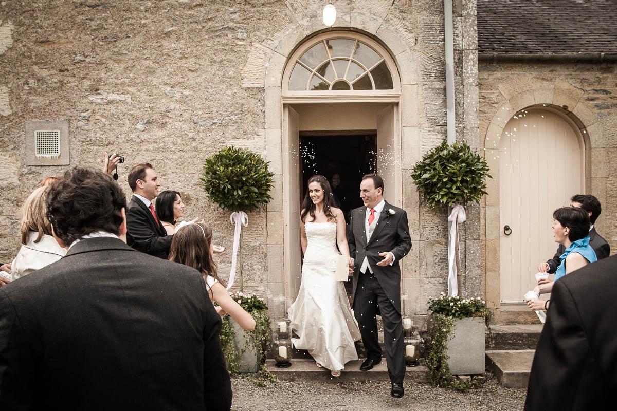 bride and groom outside at drummuir castle