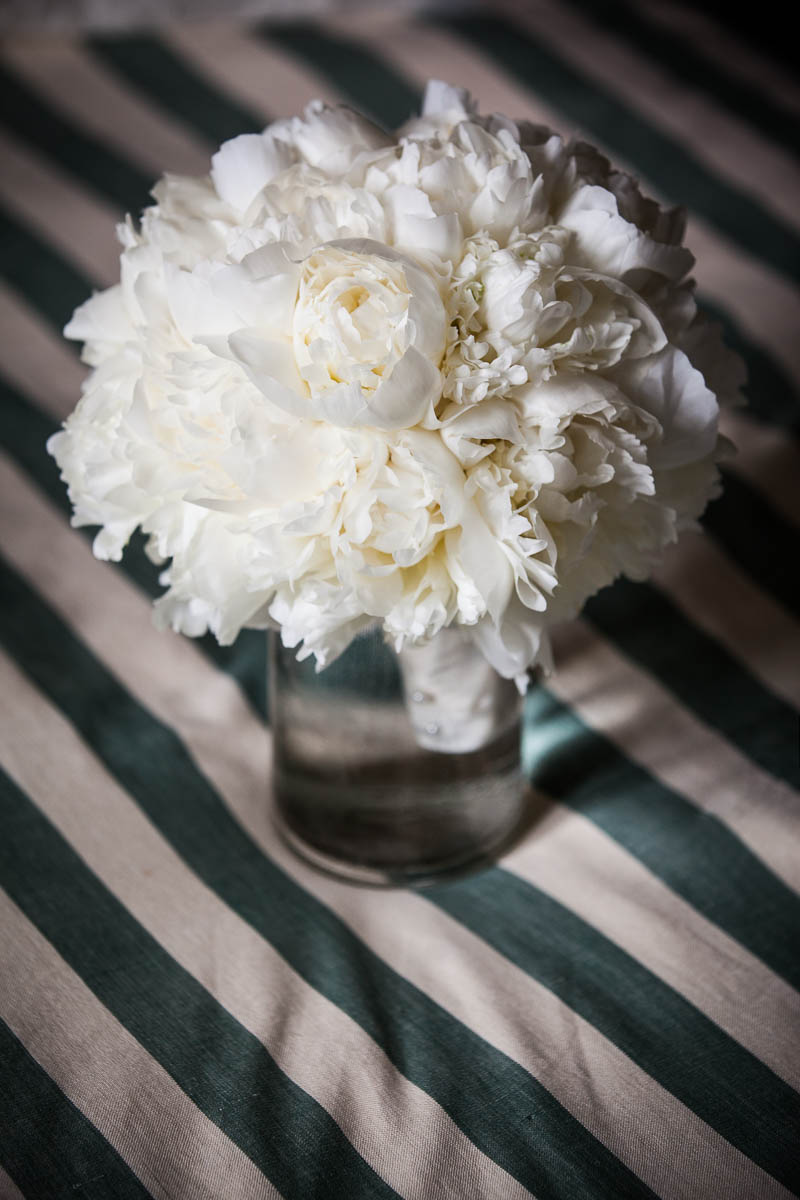 white wedding flowers on striped tablecloth