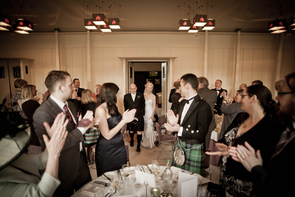 bride and groom enter reception at house for an art lover in glasgow