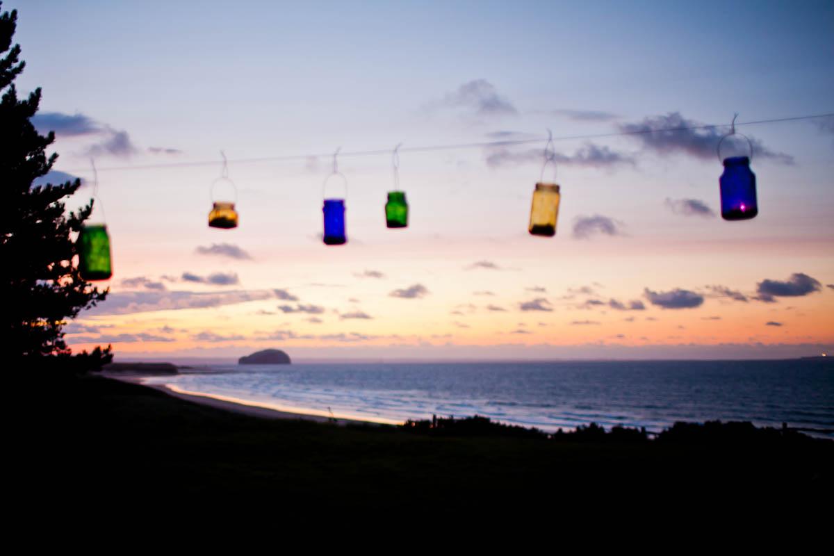 tea lights in jars at sunset at ravensheugh log cabin