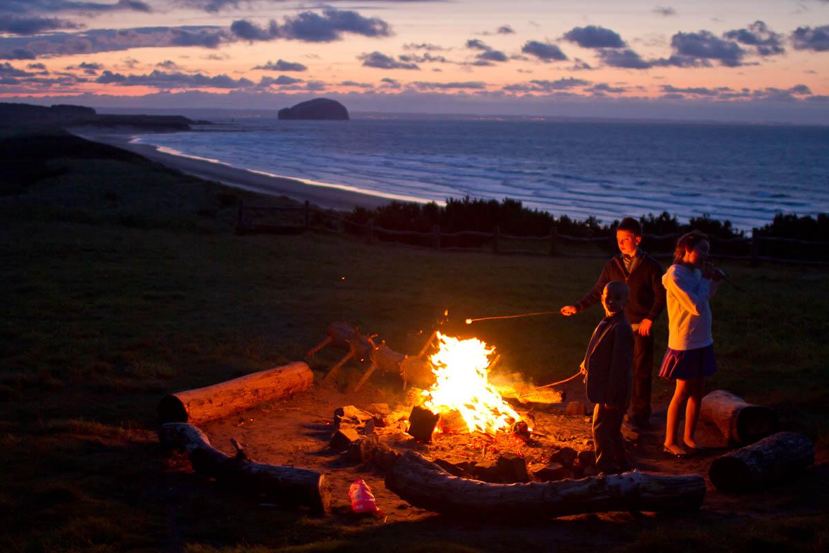 bonfire at wedding at ravensheugh log cabin
