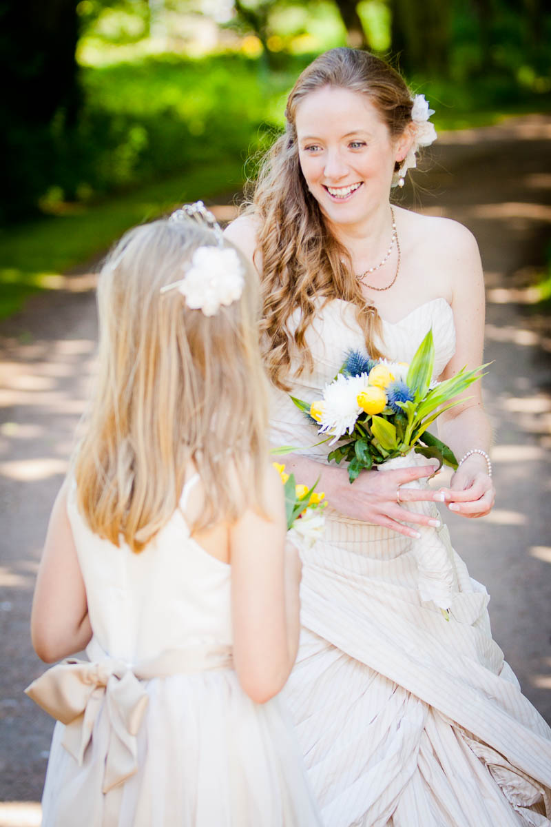 bride and flowergirl outside in woods