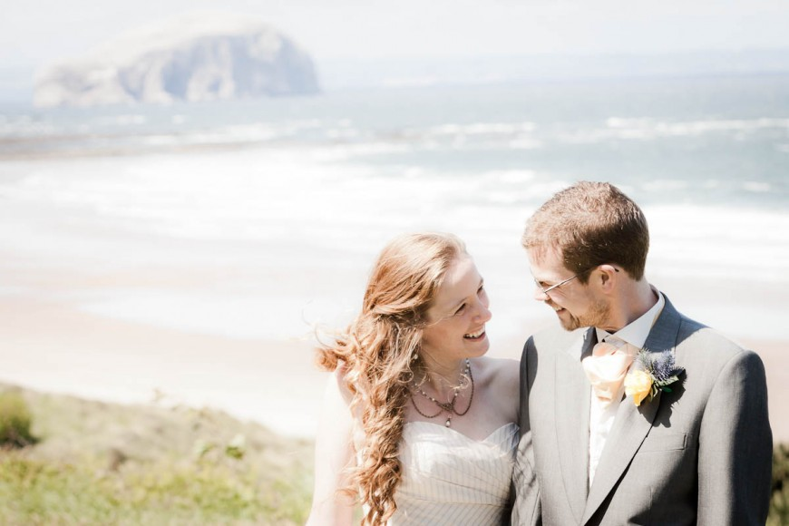 bride aand groom by sea at beach wedding
