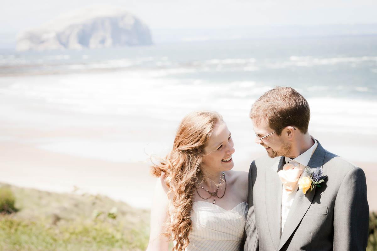 bride aand groom by sea at beach wedding